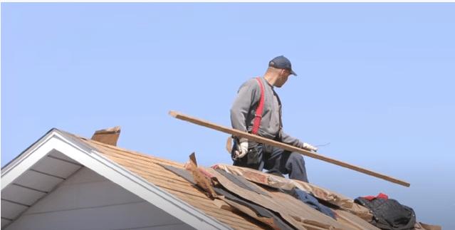 tom installing a roof in yukon